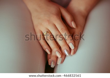 A closeup of woman's wedding manicure