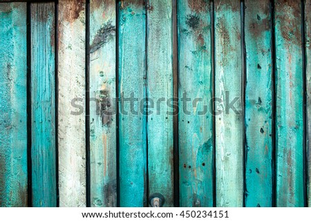 A closeup of wooden boards painted in blue color - stock photo