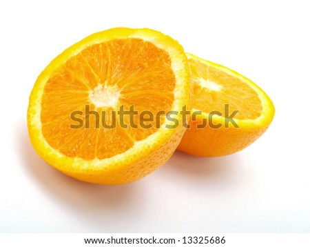 A closeup photo about two half fresh oranges on a white table - stock photo