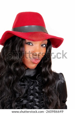 A closeup picture of a lovely African American woman in a black blouse