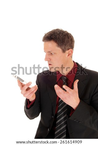 A closeup picture of a young man screaming in his cell phone, with his