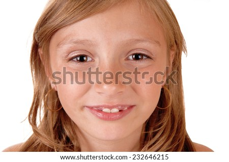 A closeup picture of the face of a eight year old girl, smiling, isolated for white background.  - stock photo