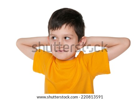 A closeup portrait of a dreaming young boy on the white background - stock photo