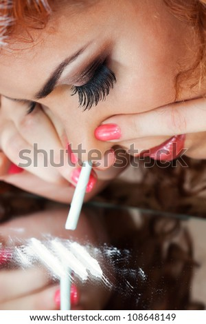 a closeup portrait of a girl using drugs - stock photo