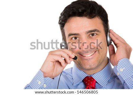 A closeup portrait of a handsome male customer service representative or operator or help desk support staff wearing a head set isolated on a white background with copy space