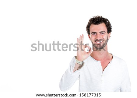 A closeup portrait of a handsome, young, happy, optimistic smiling guy telling you everything is OK, isolated on a white background with copy space. Positive human emotions and signs - stock photo