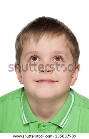 A closeup portrait of a pensive boy on the white background - stock photo