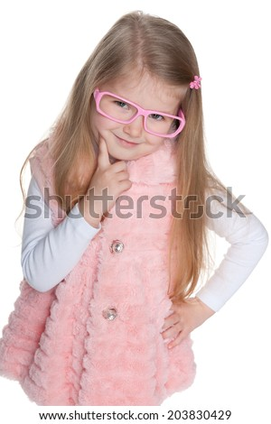 A closeup portrait of a pensive preschool girl in glasses - stock photo