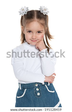 A closeup portrait of a pensive pretty preschool girl on the white background - stock photo