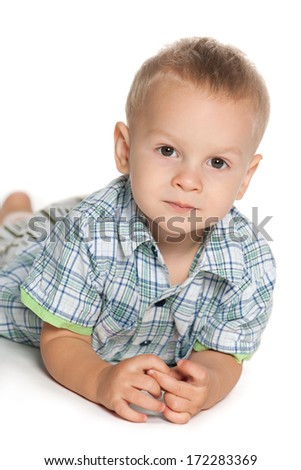 A closeup portrait of a pensive toddler boy on the white background - stock photo