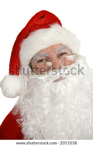 A closeup portrait of a smiling, traditional Santa Clause, over white. - stock photo