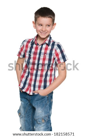 A closeup portrait of a smiling young boy on the white background - stock photo