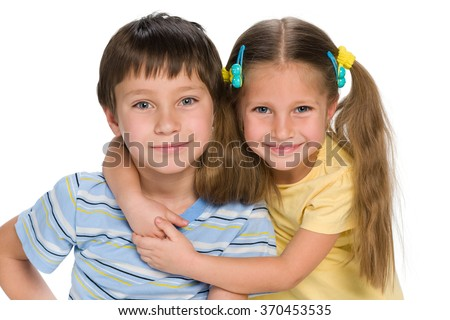 A closeup portrait of two little children together on the white background - stock photo