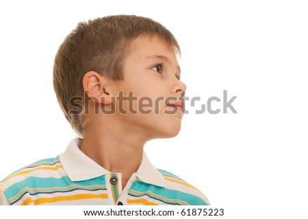 A closeup profile portrait of a seven-year-old kid isolated on the white background - stock photo