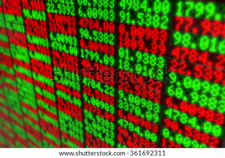 A closeup section of a digital stock market indicator board with green and red numerical figures - stock photo