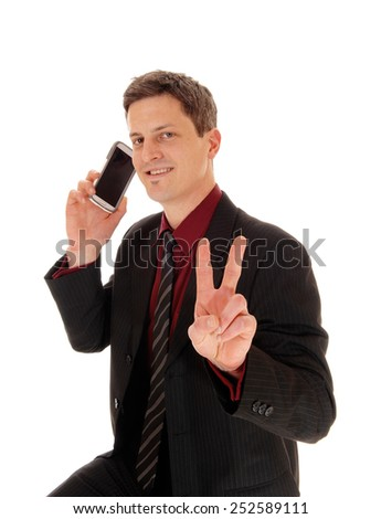 A closeup shoot of a man his cell phone on his ear and sign victory with two fingers, isolated for white background.  - stock photo