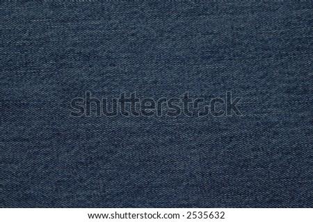 A closeup shot of a denim fabric pattern - stock photo