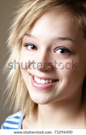 A closeup shot of a happy smiling young woman. - stock photo