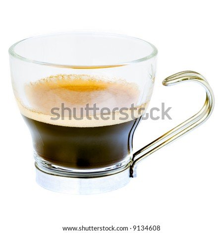 A closeup shot of a traditional italian foamy espresso coffee isolated on white background