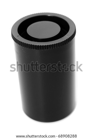 A closeup shot of an old plastic film canister used for holding photography film isolated on white background. - stock photo