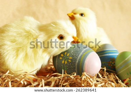 A closeup shot of Easter Eggs and Chicks. - stock photo