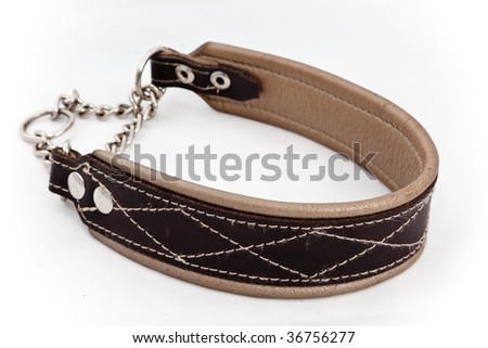 A closeup studio shot of a brown, chained leather dog collar. - stock photo