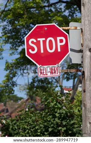 A closeup to a typical Stop Road Sign in Toronto. These are found at many intersections.