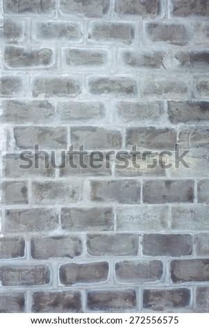 A closeup vertical image of old grey textured bricks wall. - stock photo