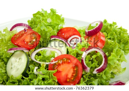 A closeup view from a salad plate. - stock photo