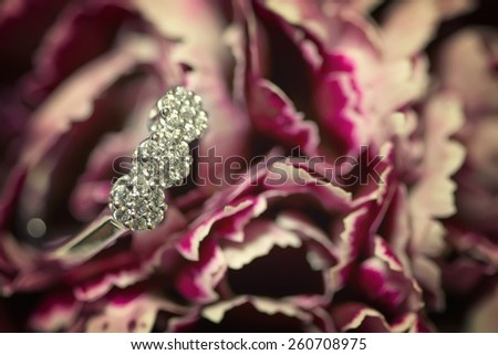 A closeup view of a diamond engagement ring - stock photo
