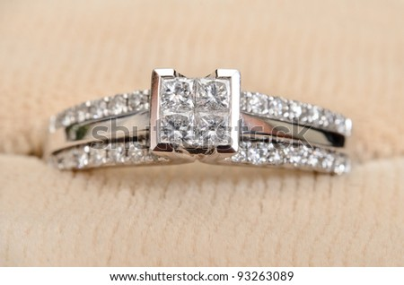 A closeup view of a diamond engagement ring, while sitting in the box. - stock photo
