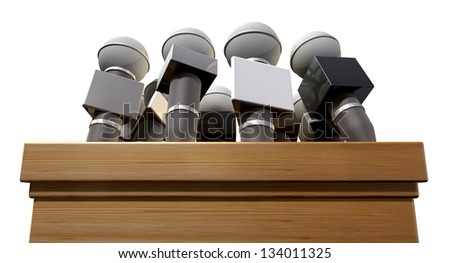 A closeup view of a wooden podium with an array of press microphones on it on an isolated background