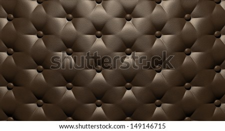 A closeup view of brown luxury buttoned leather - stock photo
