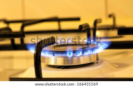A closeup view of the flames of a kitchen stove - stock photo