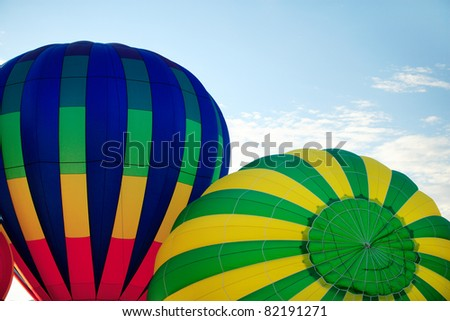 A closeup view of two hot air balloons