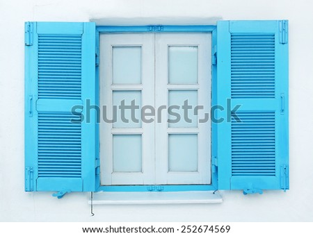 A closup of typical Greek blue window  - stock photo
