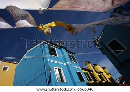 A clothesline in the sea breeze on the island of Burano - stock photo
