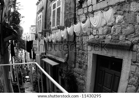 A clothesline of laundry drying. (Dubrovnik, Croatia) - stock photo