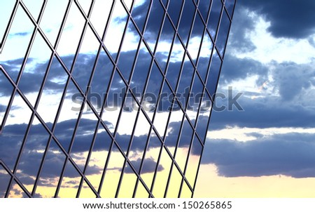 A clouds reflection in glass wall of building - stock photo