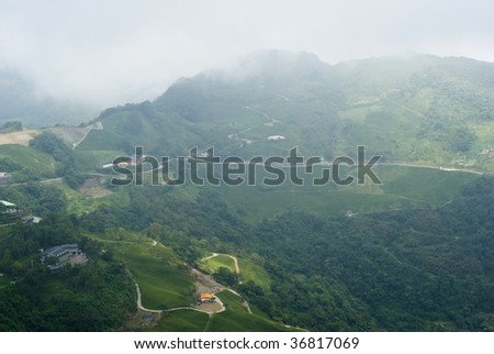a cloudy mountain village - stock photo