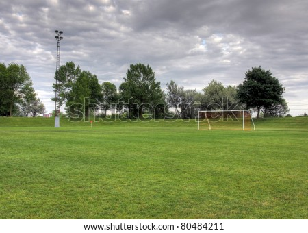 Cloudy unoccupied soccer field trees background stock photo 80484211 a cloudy unoccupied soccer field with trees in the background hdr photograph thecheapjerseys Image collections