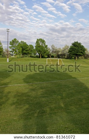 Cloudy unoccupied soccer field trees background stock photo royalty a cloudy unoccupied soccer field with trees in the background hdr photograph thecheapjerseys Image collections