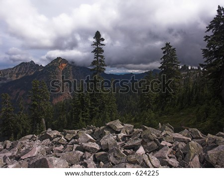 A cloudy view of Alaska Mountain and adjoining ridgeline as seen from the Pacific Crest Trail in Washington State. - stock photo