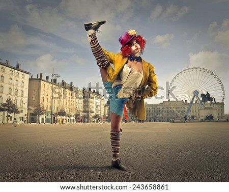 A clown in the square  - stock photo