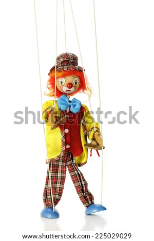A clown marionette puppet isolated on white. - stock photo