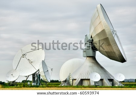 A cluster of satellite dishes at a research station - stock photo