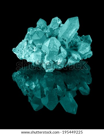 A cluster of well developed cyan limonite quartz crystals with their reflection. - stock photo