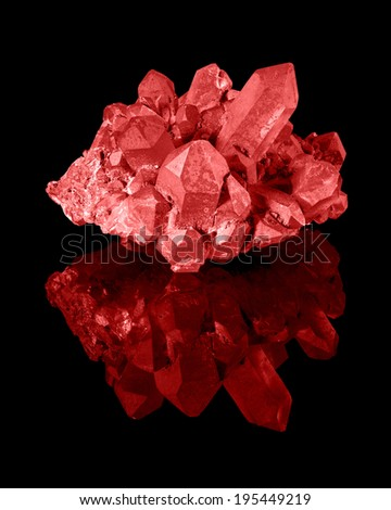 A cluster of well developed red limonite quartz crystals with their reflection. - stock photo