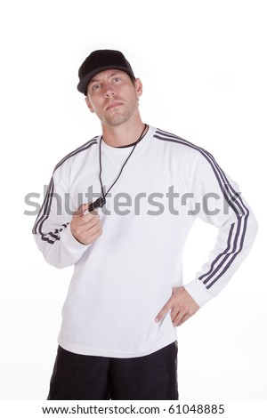 A coach is holding a whistle. - stock photo
