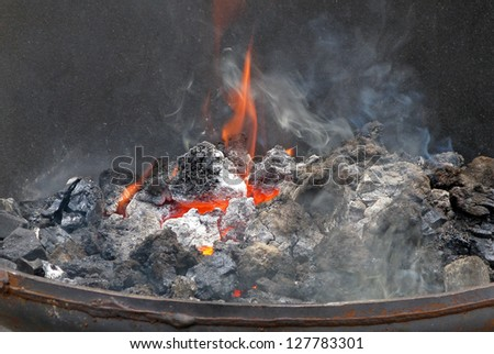 A coal fire, used by blacksmiths for metal working. - stock photo